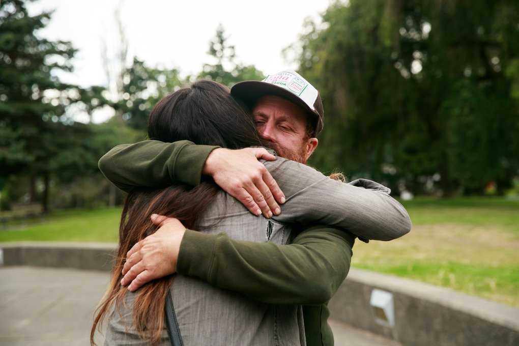 "Dave ""Shaggy"" Palmer, senior site superintendent at Grindline Skateparks, receives a hug from one of the many who attended the celebration of life for Mark Hubbard.  (Erika Schultz/The Seattle Times)"
