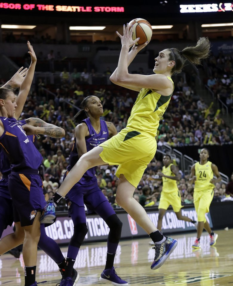 Seattle Storm's Breanna Stewart, right, gets off a shot against the Phoenix Mercury late in the second half of Game 1 of a WNBA basketball playoff semifinal Sunday, Aug. 26, 2018, in Seattle. Stewart led all scorers with 28 points as the Storm won 91-87. (AP Photo/Elaine Thompson) WAET116 WAET116 (Elaine Thompson / The Associated Press)