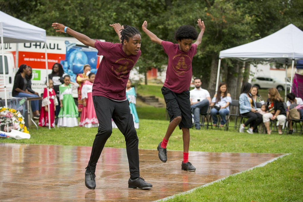 Olu Dixon, 14, and Eyoub Endris, 12, of Northwest Tap Connection, perform at the Rainier Valley Heritage and Othello International Festival Sunday at Othello Park August 12, 2018.  (Bettina Hansen / The Seattle Times)