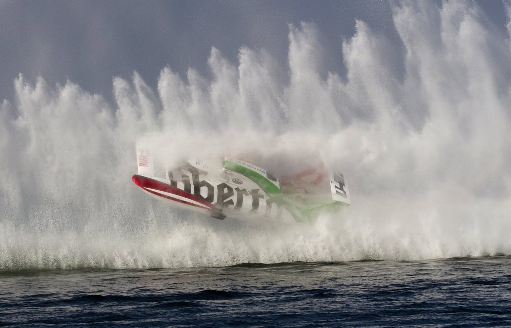 Cal Phipps driving the U-1918 Oberto Beef Jerky H1 Unlimited Hydroplane gets caught in the rooster tail from the boat in front of him during the winner-take-all final at the Albert Lee Appliance Cup on Lake Washington.  Phipps and his boat made several revolutions coming to rest right side up.  Phipps was not injured.  Photo courtesy of Greg McCorkle