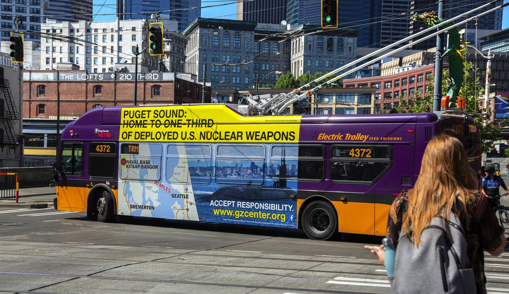 Ground Zero Center for Nonviolent Action paid for these large ads on Metro buses this summer. The provocative banners, which show a nuclear submarine cruising through Elliott Bay, are part of a long-term effort to make the burgeoning Seattle population aware of the large numbers of nuclear warheads located within 20 miles of downtown.  (Intersection)