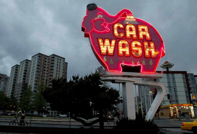 "The Elephant Car Wash with its glowing vintage sign, was deemed of ""no historical value"" in a city survey. (Alan Berner / The Seattle Times)"
