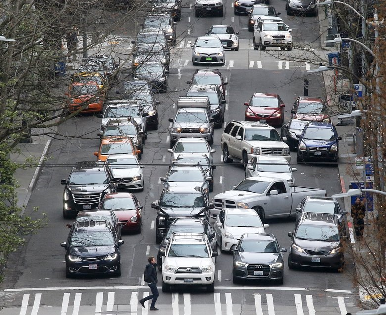 Traffic backs up on 6th Avenue in downtown Seattle. A new study examined the impact of Uber and Lyft in nine major cities, including Seattle. (Greg Gilbert/The Seattle Times)