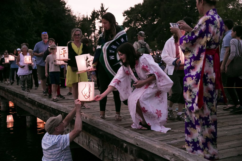Hundreds attend the From Hiroshima to Hope lantern-floating ceremony at Green Lake in Seattle on Monday.  (Erika Schultz/The Seattle Times)