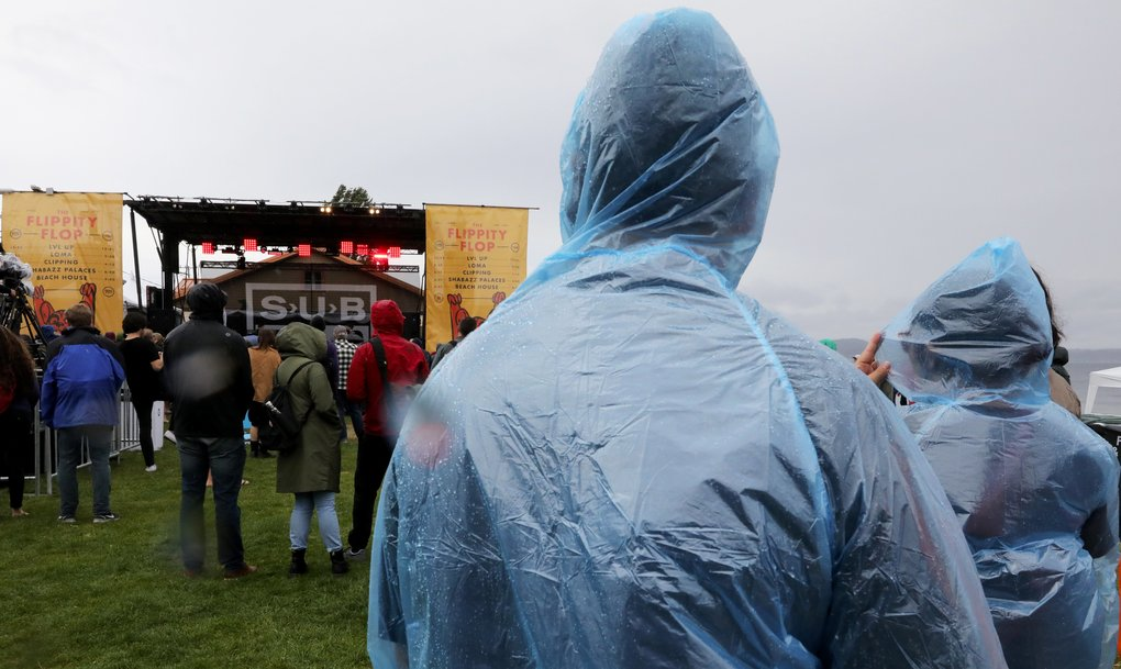 Some music fans came prepared for the intermittent rains on Saturday.  (Alan Berner/The Seattle Times)