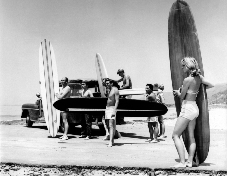 FILE – In this July 12, 1961 file photo members of the North Bay surfing club upload their surf boards from a station wagon at Malibu Beach, Calif, California Gov. Jerry Brown announced Monday, Aug. 20, 2018 that he signed a bill making surfing the official state sport. (AP Photo,File)