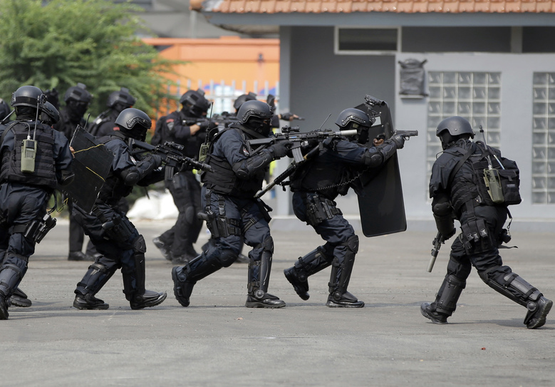 In this July 25, 2018, photo, members of joint Indonesian police and military special forces take part in an anti-terrorism drill ahead of the 2018 Asian Games in Jakarta, Indonesia. Indonesia is deploying 100,000 police and soldiers to provide security for the Asian Games, the biggest event ever held in its terror attack prone capital Jakarta, parts of which have been dramatically spruced up as the city readies to welcome tens of thousands of athletes and visitors. (AP Photo/Tatan Syuflana)