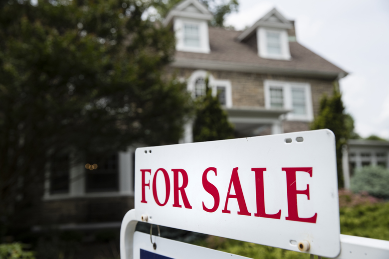 FILE- In this June 8, 2018, file photo a for sale sign stands in front of a house, in Jenkintown, Pa. On Tuesday, Aug. 28, the Standard & Poor's/Case-Shiller 20-city home price index for June is released. (AP Photo/Matt Rourke, File)