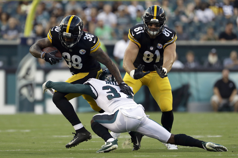 Pittsburgh Steelers' Jaylen Samuels (38) is tackled by Philadelphia Eagles' Jalen Mills (31) during the first half of a preseason NFL football game Thursday, Aug. 9, 2018, in Philadelphia. (AP Photo/Michael Perez)