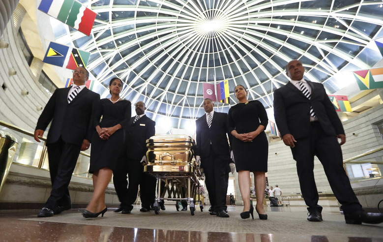 The casket of legendary singer Aretha Franklin is moved from the Charles H. Wright Museum of African American History in Detroit on Wednesday. She died Aug. 16. (AP Photo/Paul Sancya)