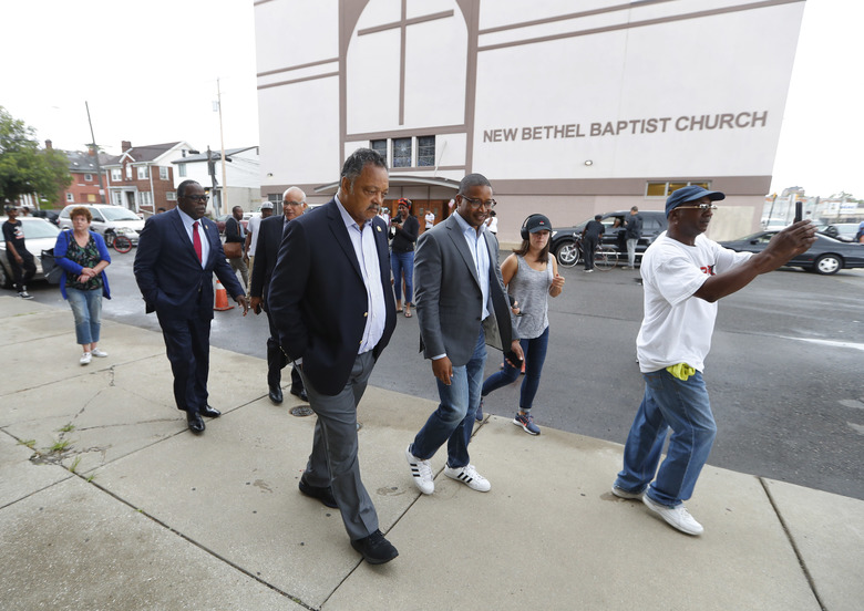 """Rev. Jesse Jackson walks outside New Bethel Baptist Church in Detroit, Thursday, Aug. 16, 2018. Aretha Franklin, the undisputed """"Queen of Soul"""" who sang with matchless style on such classics as """"Think,"""" """"I Say a Little Prayer"""" and her signature song, """"Respect,"""" and stood as a cultural icon around the globe, died Thursday at age 76 from pancreatic cancer. C.L. Franklin, her father, had been pastor at the church that Franklin learned the gospel fundamentals that would make her a soul institution. (AP Photo/Paul Sancya)"""