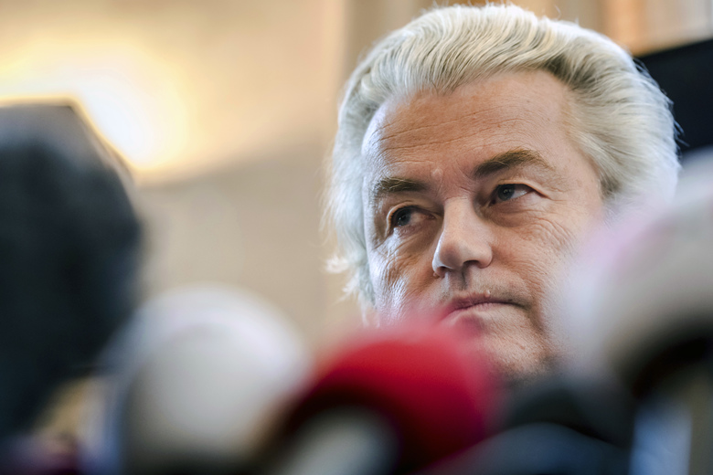 "FILE – In this Friday, Nov. 3, 2017 file photo, Dutch far-right leader Geert Wilders addresses the media at the Belgian federal parliament in Brussels. The Dutch prime minister has distanced his government from a Prophet Muhammad cartoon contest being organized later this year by anti-Islam lawmaker Geert Wilders. Prime Minister Mark Rutte said Friday, Aug. 24, 2018 that Wilders ""is not a member of the government. The competition is not a government initiative."" (AP Photo/Geert Vanden Wijngaert, file)"