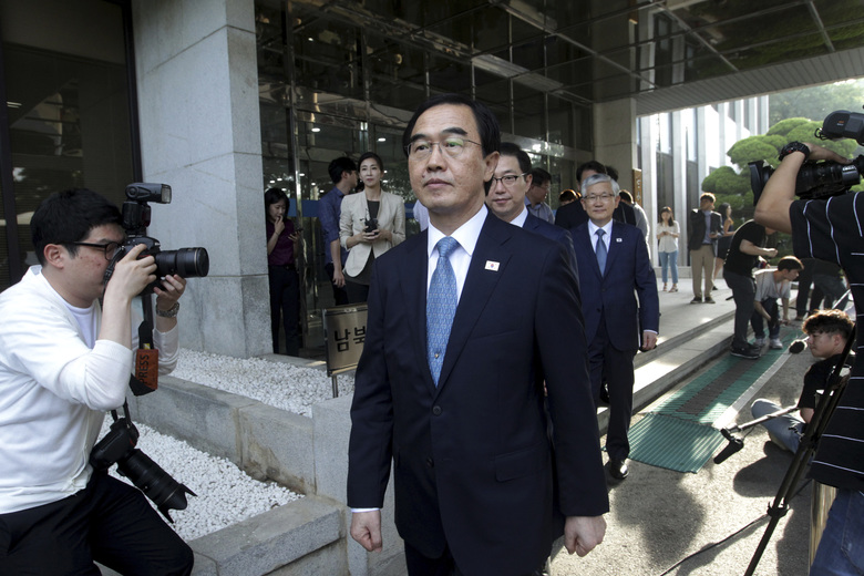 South Korean Unification Minister Cho Myoung-gyon leaves for the border village of Panmunjom to attend a meeting between South and North Korea, at the Office of the South Korea-North Korea Dialogue in Seoul, South Korea, Monday, Aug. 13, 2018. (AP Photo/Ahn Young-joon)