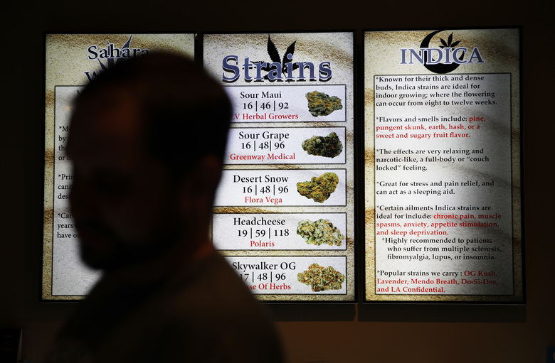 In this July 30, 2018, photo, screens display different strains of marijuana at 420 Sahara Wellness in Las Vegas. Nevada regulators and industry insiders say the state's first year of adult-use marijuana sales has exceeded their expectations. (AP Photo/John Locher)