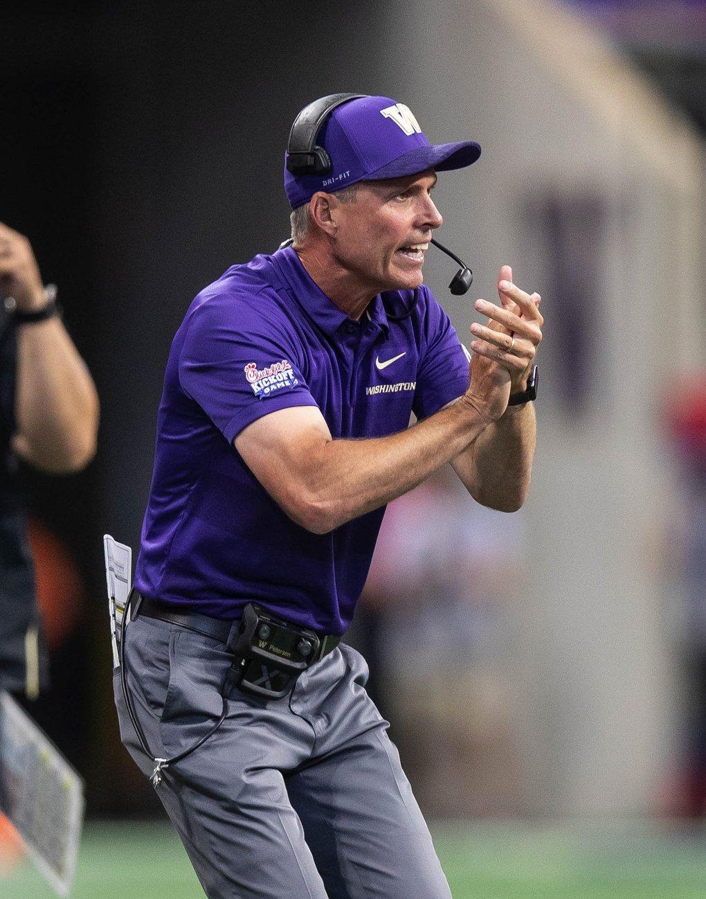 Chris Petersen tries to rally his team against Auburn. (Dean Rutz / The Seattle Times)