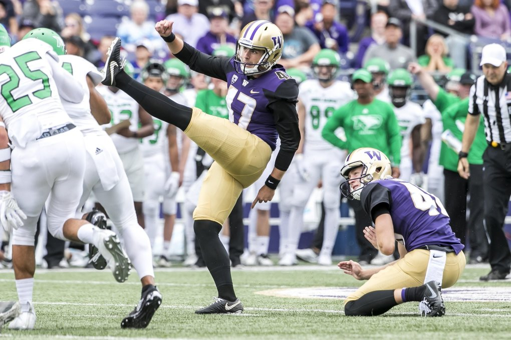 Huskies place kicker Peyton Henry, with punter Race Porter holding. (Bettina Hansen / The Seattle Times)