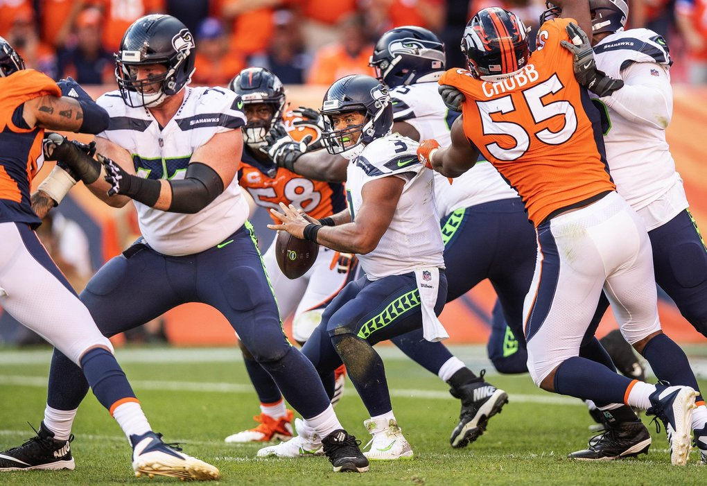 With :02 seconds to play, 3rd down and 19, Russell Wilson looks to make a desperation pass.  But Denver closes in on him and makes him throw it away.  Wilson was sacked 6 times for 56 yards in a 27-24 loss to Denver. (Dean Rutz / The Seattle Times)