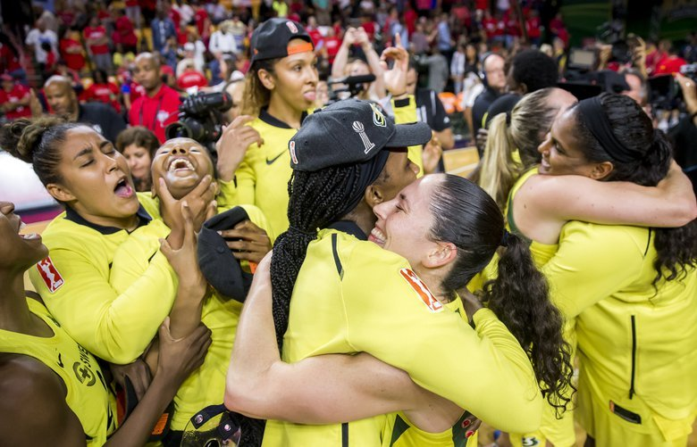 Storm guard Sue Bird hugs forward Crystal Langhorne after the Seattle Storm swept the Washington Mystics to win the WNBA Finals at EagleBank Arena in Fairfax, Virginia Wednesday September 12, 2018. 207691