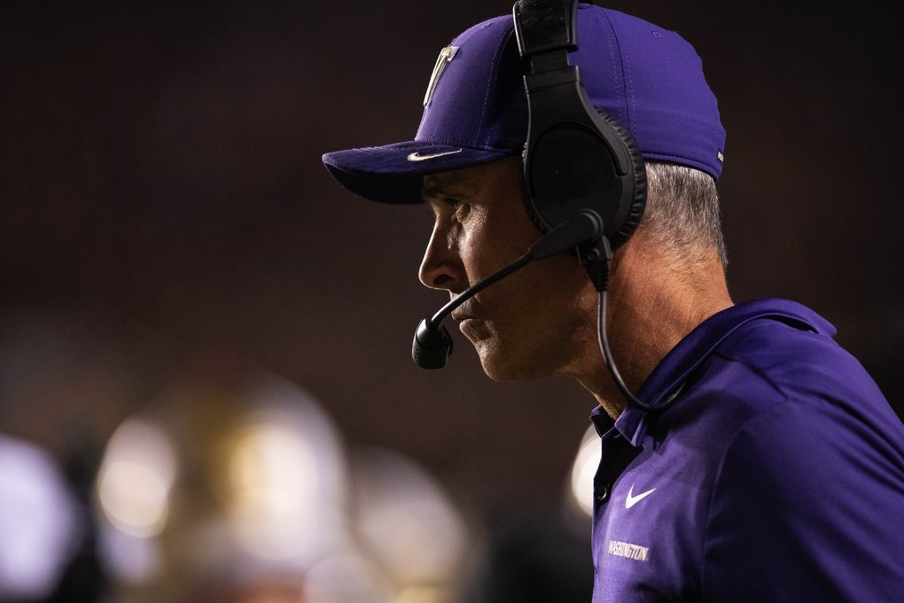 Washington coach Chris Petersen watches from the sidelines Saturday. (Dean Rutz / The Seattle Times)