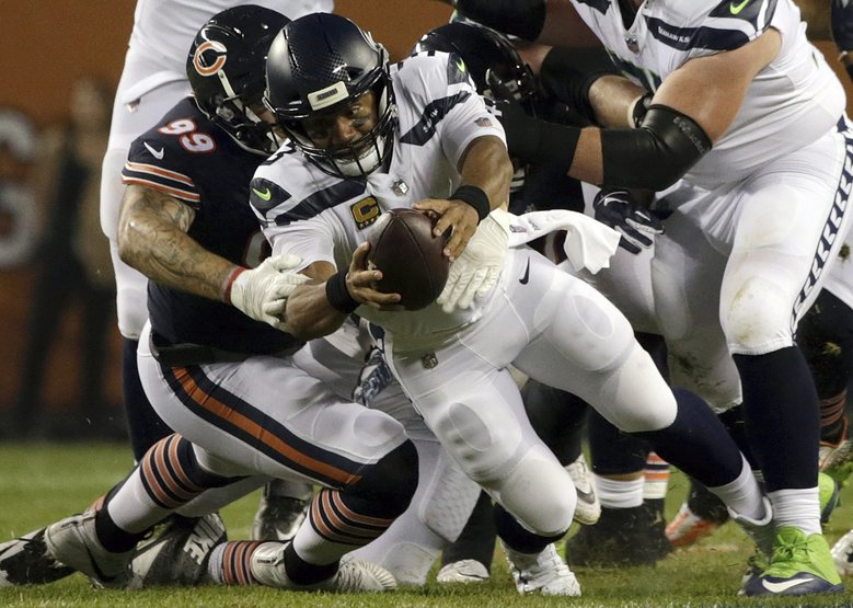 Chicago Bears linebacker Aaron Lynch (99) sacks Seattle Seahawks quarterback Russell Wilson (3) during the first half of an NFL football game Monday, Sept. 17, 2018, in Chicago. (David Banks / The Associated Press)