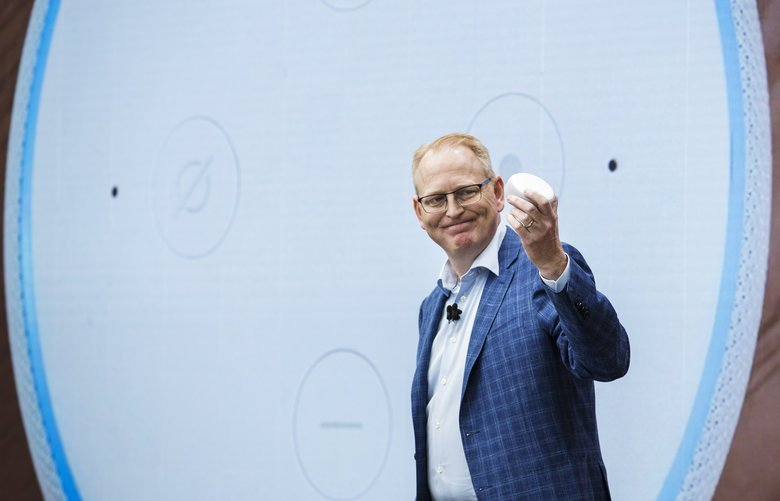 David Limp, senior vice president of devices and services at Amazon.com Inc., holds up an Amazon Echo Dot smart speaker during an unveiling event at the company's Spheres headquarters in Seattle, Washington, U.S., on Thursday, Sept. 20, 2018. Amazon.com Inc.?unveiled its vision for smart homes powered by the Alexa voice assistant, with a dizzying array of new gadgets and features for almost every room in the house — from a microwave oven to a security camera and wall clock. Photographer: Andrew Burton/Bloomberg 775231236