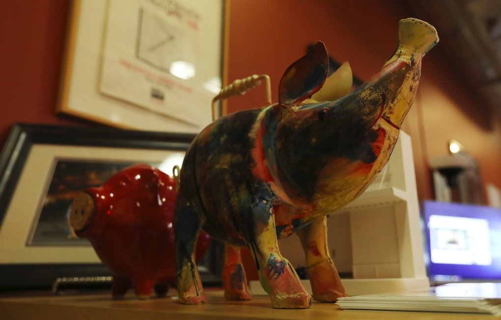 Visitors to the Pike Place Market Foundation's office often leave depictions of pigs. (Alan Berner / The Seattle Times)