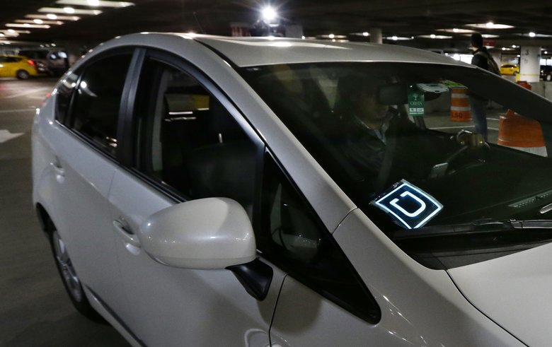 People who drove for Uber in Washington in 2013 and 2014 will receive $170 each to settle a lawsuit over a data breach the company initially didn't report. (AP Photo/Ted S. Warren/File)