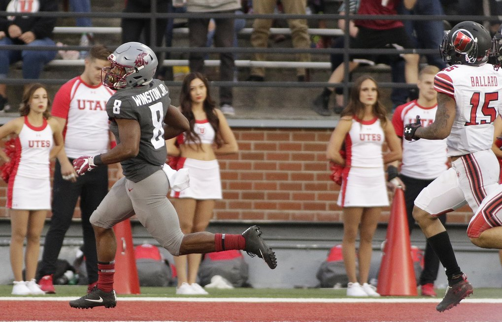 Washington State wide receiver Easop Winston Jr. scores the winning touchdown against Utah. (AP Photo/Young Kwak)