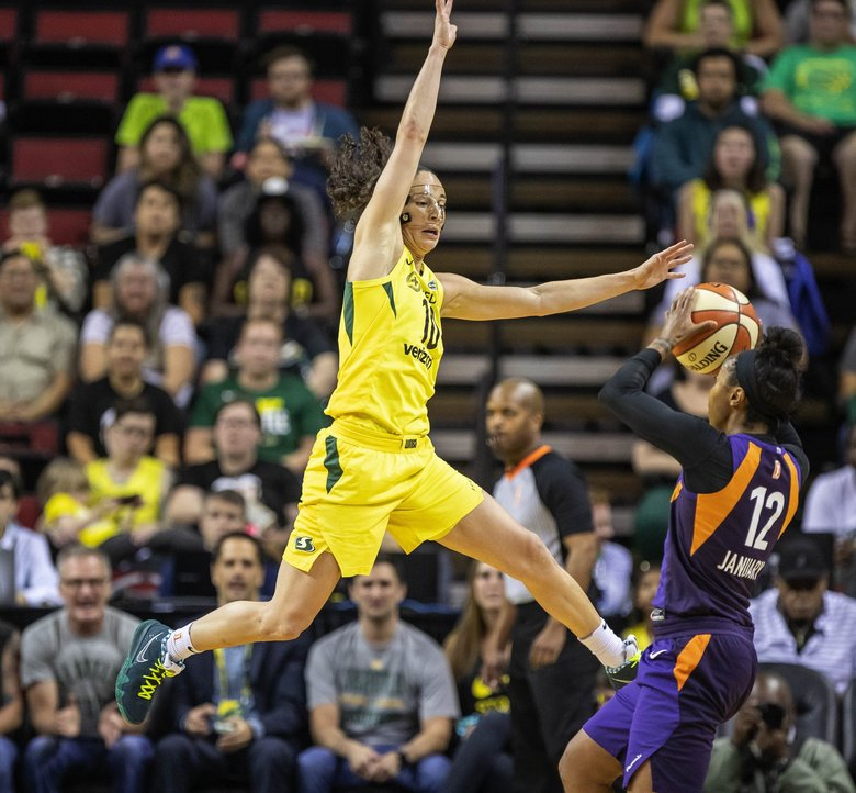 Sue Bird applies pressure to Phoenix's Briann January in the 1st quarter. (Dean Rutz / The Seattle Times)