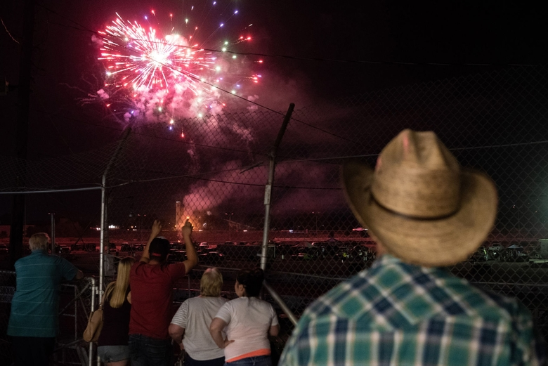 Fans watch the fireworks show after a night of races. (Oliver Hamlin/Yakima Herald-Republic)