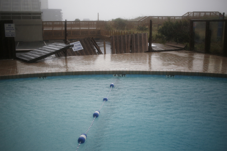 Signs of damage from  Hurricane Florence at an oceanfront hotel in North Myrtle Beach, S.C., Sept. 15, 2018. Now a tropical storm, Florence continued its torrential roll through the Carolinas on Saturday; some cities have already seen 30 inches of rain, with more to come. At least five people have died. (Luke Sharrett/The New York Times)