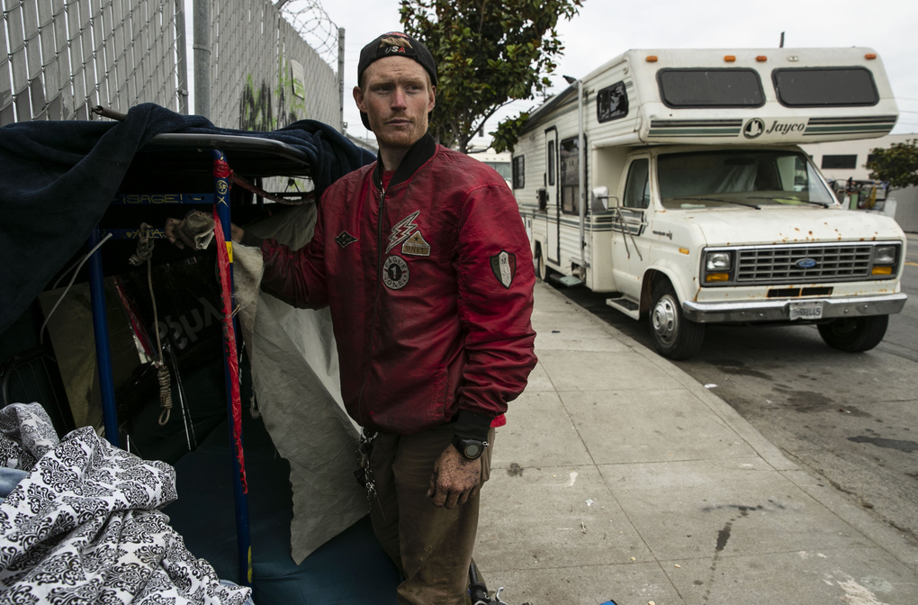 Sage Haithcoat, 27, works on creating a space for a shelter in San Francisco's Bayview neighborhood, an industrial area on the city's southeast side. More than a dozen RVs and buses were parked in the area. (Erika Schultz / The Seattle Times)