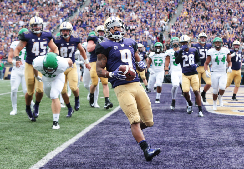 Myles Gaskin runs in the Huskies' second touchdown, bringing the score to 17-0 in the second quarter against North Dakota. (Bettina Hansen / The Seattle Times)
