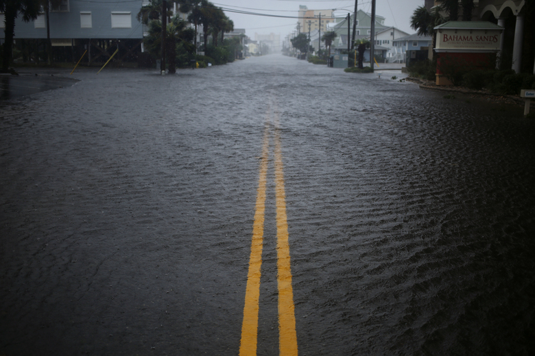 A street flooded by rains from Hurricane Florence in Myrtle Beach, S.C., Sept. 14, 2018. Florence, which was downgraded to a tropical storm on Friday, was pounding the Carolinas with as much as three inches of rain per hour as it trudged inland; at least five deaths have been reported. (Luke Sharrett/The New York Times)