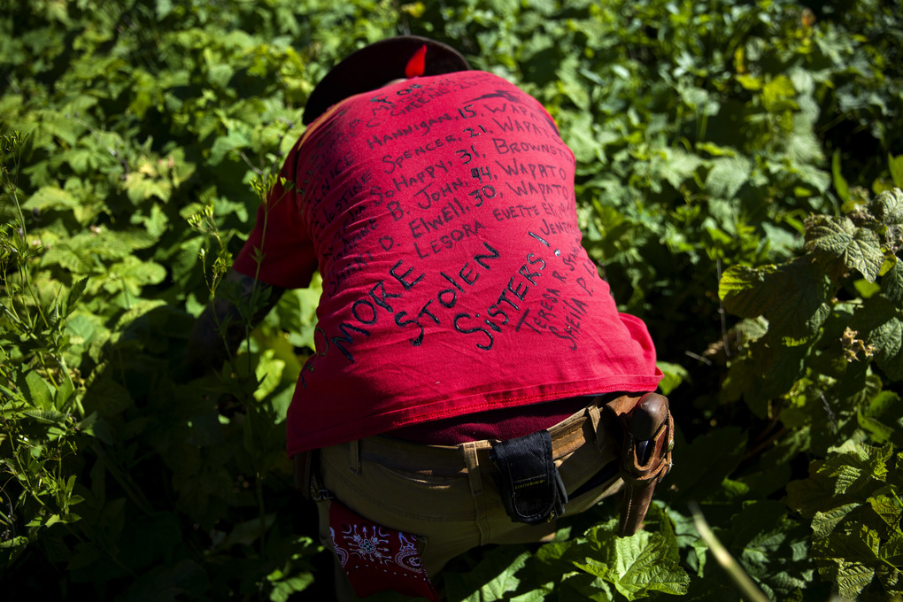 Randy Ortiz wears a shirt with the names of missing and murdered indigenous women as he searches July 12 for Ashley HeavyRunner Loring in the mountains of the Blackfeet Indian Reservation in Babb, Mont.  (David Goldman/AP)