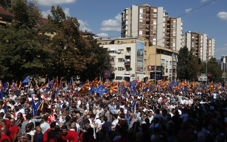 "People waving Macedonian and EU flags take part in a march named ""For European Macedonia"", through a street in Skopje, Macedonia, Sunday, Sept. 16, 2018. Thousands of people marched in downtown of capital Skopje Sunday to support a forthcoming key referendum on changing Macedonia's name that could clear the way for the country to join NATO. (AP Photo/Boris Grdanoski)"