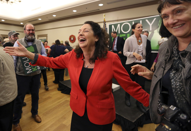 New Hampshire Democratic gubernatorial hopeful Molly Kelly, middle, greets supporters at her primary night victory party, Tuesday, Sept. 11, 2018, in Keene, N.H. (AP Photo/Elise Amendola)