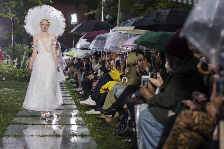 A model walks in the Rodarte show, which was held outside in the rain, during Fashion Week on Sunday, Sept. 9, 2018 in New York. (Photo by Charles Sykes/Invision/AP)