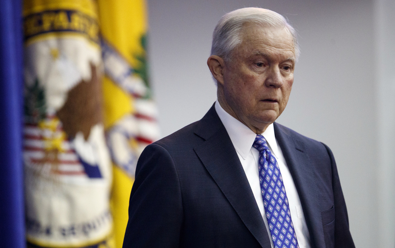 Attorney General Jeff Sessions pauses on the dias as he is introduced to speak during the Office of Justice Programs' National Institute of Justice Opioid Research Summit in Washington, Tuesday, Sept. 25. (AP Photo/Carolyn Kaster)