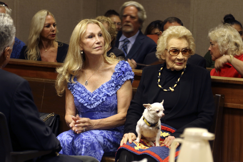 Abigail Kawananakoa, right, and her wife Veronica Gail Worth, appear in state court in Honolulu on Monday, Sept. 10, 2018. A judge has ruled that a 92-year-old Native Hawaiian heiress doesn't have sufficient mental capacity to manage her $215-million trust and is appointing First Hawaiian Bank to serve as her trustee. (AP Photo/Jennifer Sinco Kelleher)