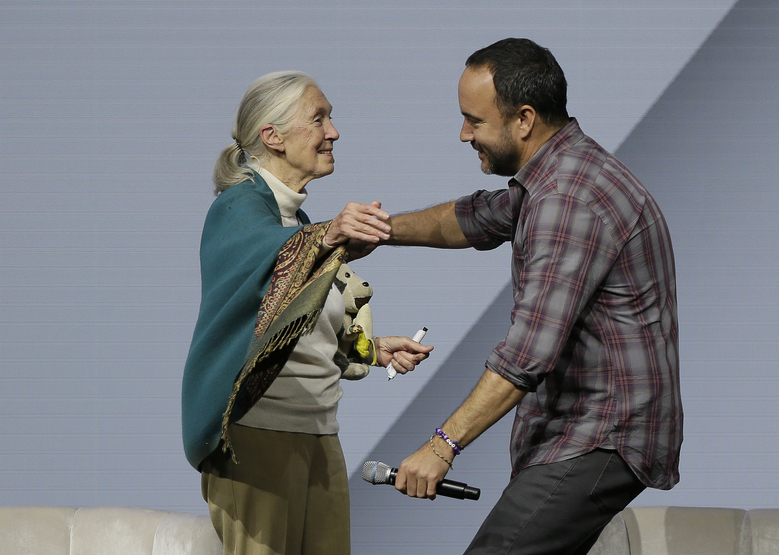 Jane Goodall, Primatologist and United Nations Messenger of Peace, is embraced by singer Dave Matthews during the Global Action Climate Summit Friday, Sept. 14, 2018, in San Francisco. California Gov. Jerry Brown's international climate summit wraps up Friday with a call to action on reducing greenhouse gas emissions, increasing renewable energy and other Earth-friendly initiatives ahead of the next United Nations climate meeting in 2020. (AP Photo/Eric Risberg)
