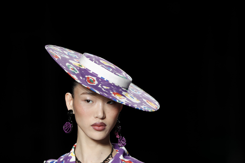 A model wears a creation as part of the Moschino women's 2019 Spring-Summer collection, unveiled during the Fashion Week in Milan, Italy, Thursday, Sept. 20, 2018. (AP Photo/Antonio Calanni)
