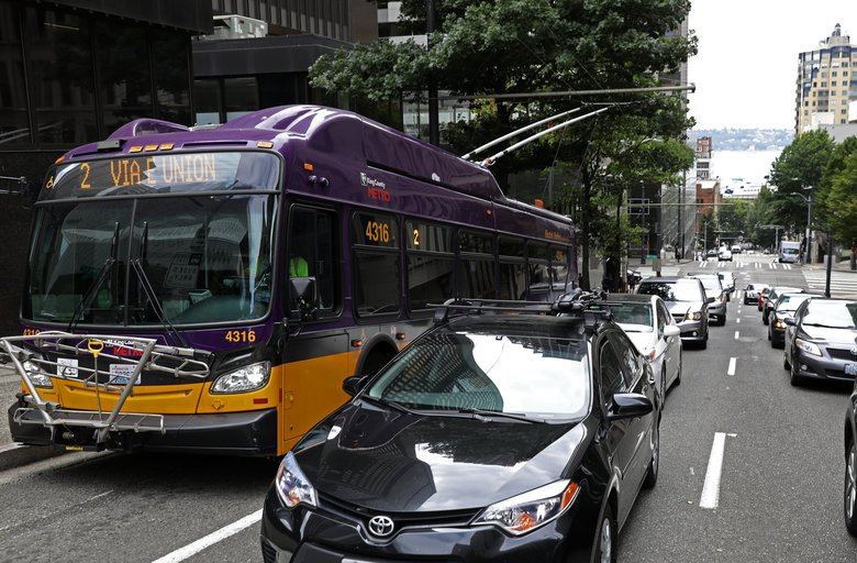 The No. 2 bus comes up Spring Street in downtown Seattle. the city of Seattle will require many businesses to offer workers the opportunity to pay for their transit commutes with pretax wages. (Ken Lambert / The Seattle Times)