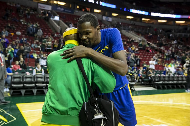 "Former sonic Donald Earl ""Slick"" Watts gives Kevin Durant a hug before the Golden State Warriors versus Sacramento Kings game in Seattle Friday, Oct. 5, 2018.  (Erika Schultz / The Seattle Times)"