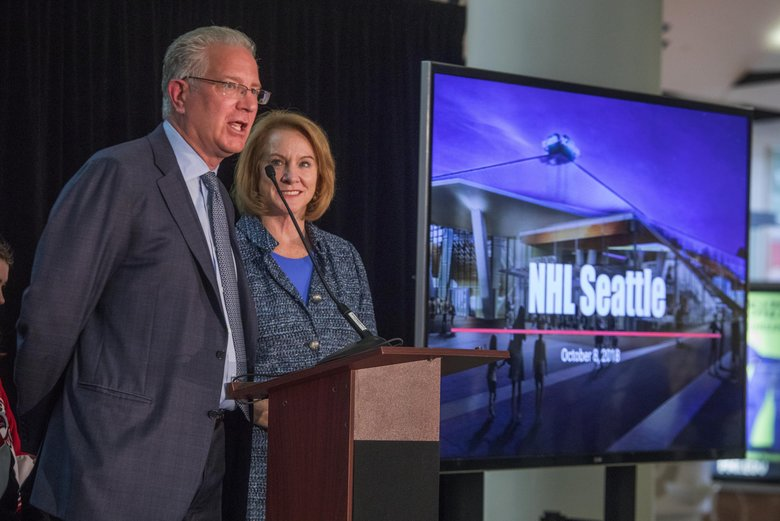 Tod Leiweke, CEO of NHL Seattle, and Seattle Mayor Jenny Durkan announce plans for an NHL franchise practice facility to be built at Northgate. (Steve Ringman / The Seattle Times)