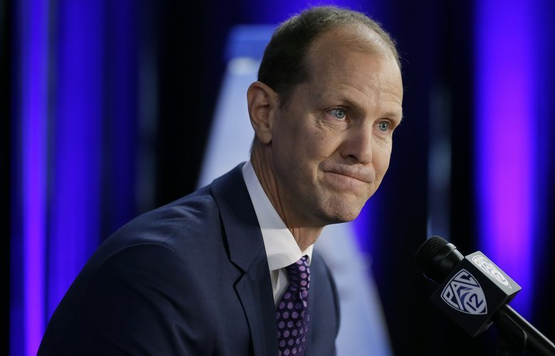 Washington head coach Mike Hopkins takes questions during the Pac-12 NCAA college basketball media day Thursday, Oct. 11, 2018, in San Francisco. (AP Photo/Eric Risberg)