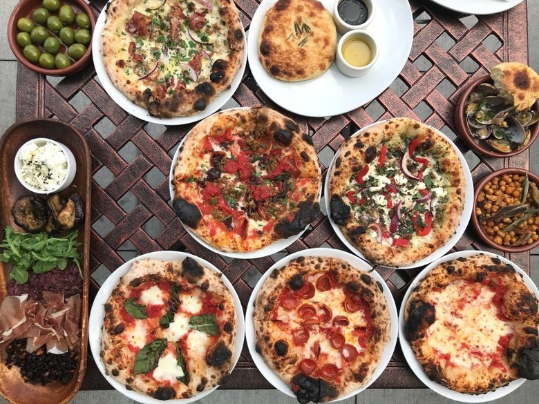 Mioposto, with four locations in Seattle and on the Eastside, does $7-$9 pizzas during happy hour.   (Courtesy of Mioposto)