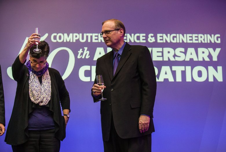 University of Washington President Ana Mari Cauce joins in the toast to Paul Allen, whose donation in 2017 led to the creation of the Paul. G. Allen School of Computer Science and Engineering.  (Dean Rutz / The Seattle Times)