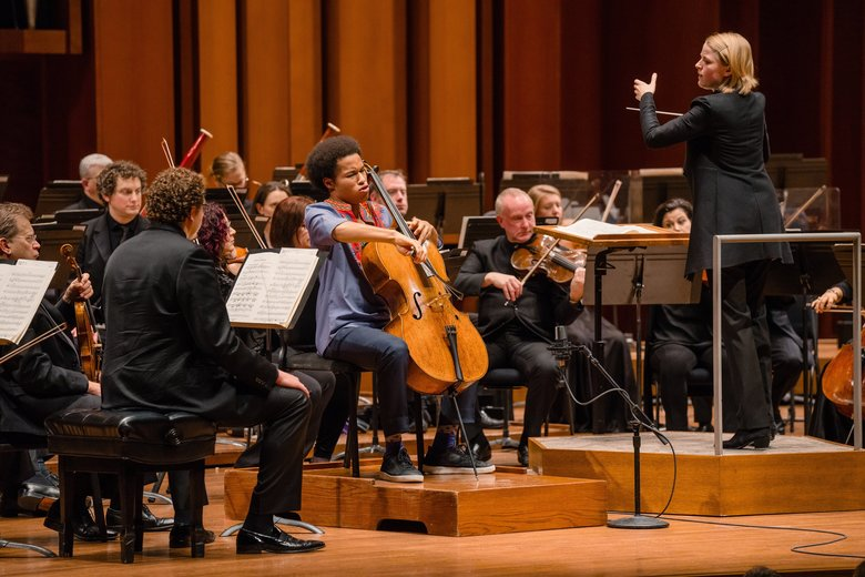 Guest soloist cellist Sheku Kanneh-Mason and guest conductor Ruth Reinhardt with Seattle Symphony.  (Brandon Patoc)