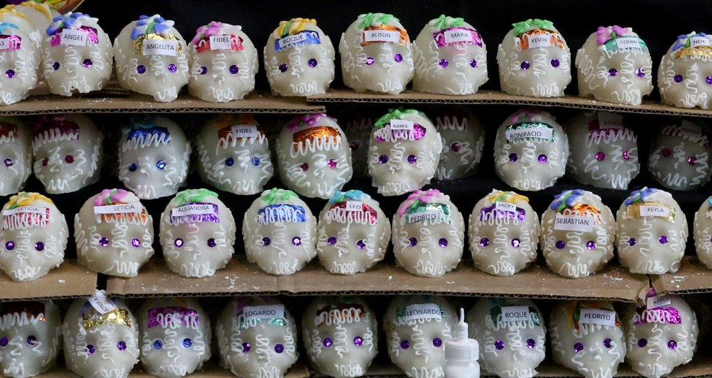 Sugar skulls personalized with names sell for $4 at the festival at the Seattle Center Armory.  Día de Muertos is a celebration to honor the memory of loved ones, to reconnect the living with the departed. (Alan Berner / The Seattle Times)